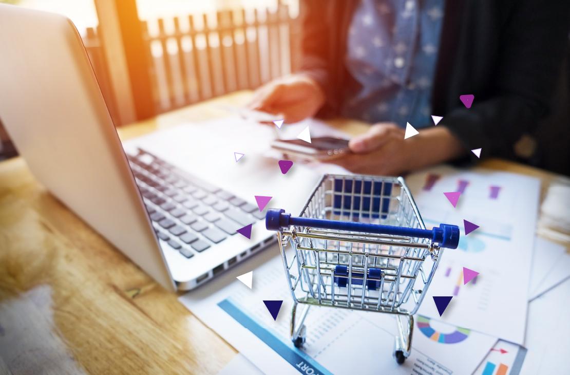 Laptop y carrito de compras representando ventas en Mercado Libre